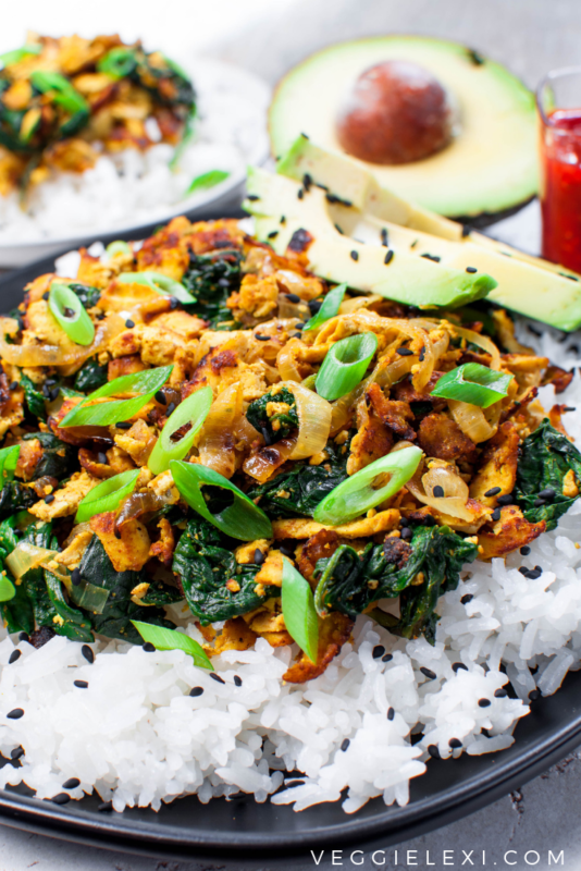 Easy and delicious new take on tofu! Shredding super firm tofu gives a wonderful texture. Serve with caramelized onion, spinach, some curry flavor, avocado, rice, and sesame seeds for the perfect quick weeknight meal! #veggielexi #veganrecipes #tofu #tofurecipes #glutenfreerecipes #vegandinner - by Veggie Lexi