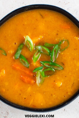 Delicious spicy sweet potato and red lentil soup! Vegan, gluten free, and made in the slow cooker. Even better, it's refined sugar free and uses the natural sweetness from frozen pineapple to balance out the heat from the chili paste. #veggielexi #slowcookerrecipes #veganrecipes #vegansoup #glutenfreerecipes - by Veggie Lexi