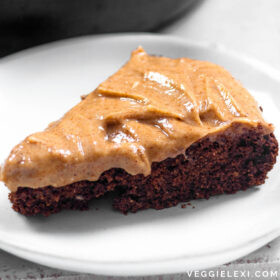 Easy and delicious chocolate skillet cake with almond butter icing. Vegan and gluten free, too! #veggielexi #veganrecipes #vegandessert #glutenfreerecipes - by Veggie Lexi