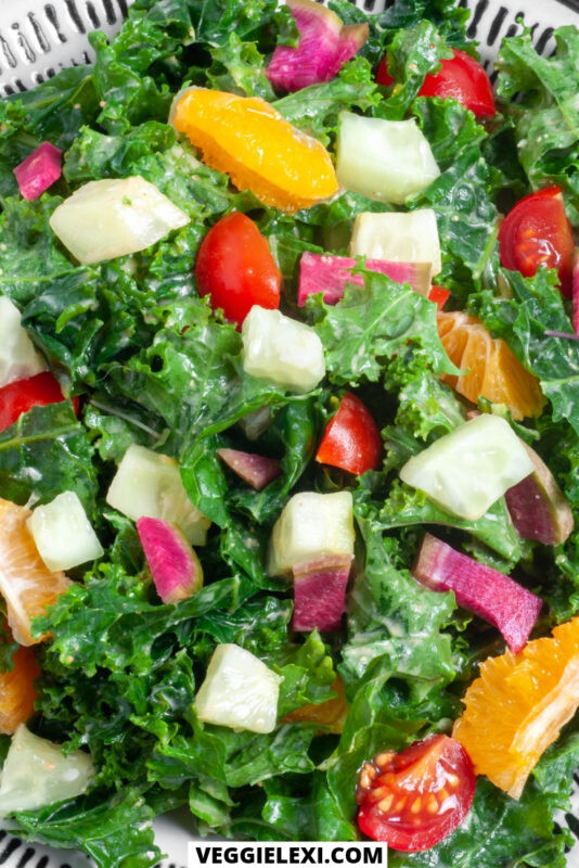 Kale salad with clementine, cucumber, watermelon radish, and cherry tomatoes. Vegan, gluten free, oil free. - by Veggie Lexi