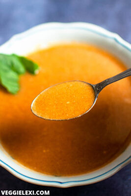 Delicious pumpkin soup that's savory, full of Fall spices, and just a hint of sweet. It comes together in only 5 minutes, one pot, and without blending. - by Veggie Lexi