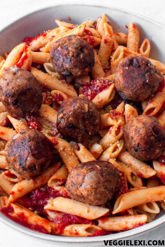 Delicious vegan and gluten free meatballs made with mushrooms and oat flour. Perfect for pasta or in a sub! #veggielexi #veganrecipes #glutenfreerecipes #veganmeatballs - by Veggie Lexi